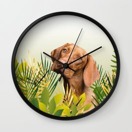Brown Dog in field with green Leaves Wall Clock