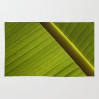 banana leaf Area & Throw Rugs featuring Banana Leaf by Maria Heyens