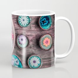 Beautiful floral composition with colorful flowers floating in water on dark wooden table. Coffee Mug
