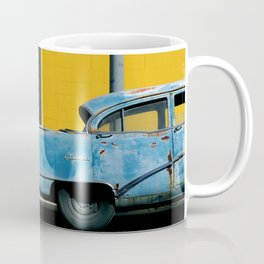Rusty Blue Car and Yellow Wall Coffee Mug