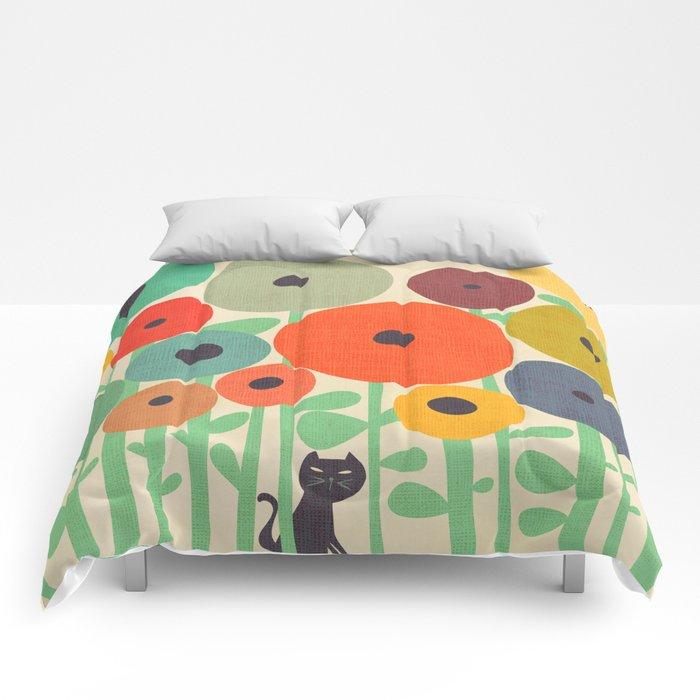 Cat in flower garden Comforters