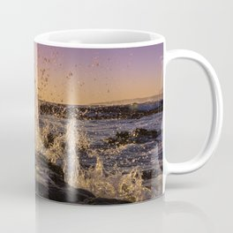 Magical sunset and waves breaking over rocky beach Coffee Mug
