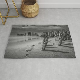 Footprints and Pilings on the Beach in Black and White at Kirk Park by Grand Haven Michigan Rug