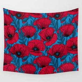 Red poppy garden on blue Wall Tapestry
