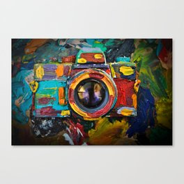 Painted old film camera on art background of palette covered with paint strokes. Canvas Print
