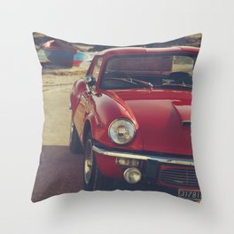 Red supercar and a boat, Triumph Spitfire by the sea, english sports car, British car Throw Pillow