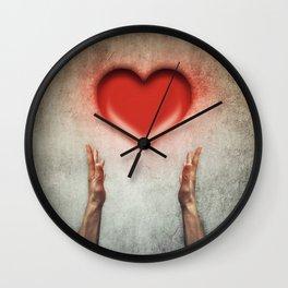 heart holding Wall Clock