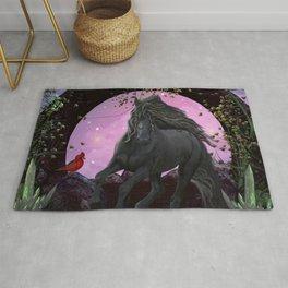 Wonderful black unicorn in the night Rug
