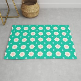 White and pink flowers with blue dots on turquoise background Rug