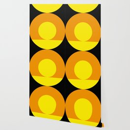 Two suns, one yellow with orange rays,the other orange with yellow rays,both floating in a black sky Wallpaper