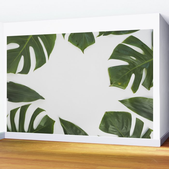 Green monstera leaves on white ink Wall Mural