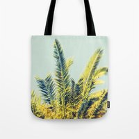 palm Tote Bags featuring Palm by Esther Ní Dhonnacha