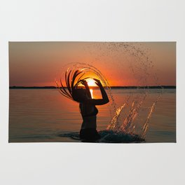 Water and sunset in the backlight Rug
