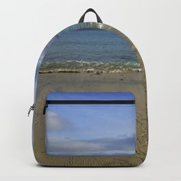 Patterns in the Sand with Blue Skies Above Backpack