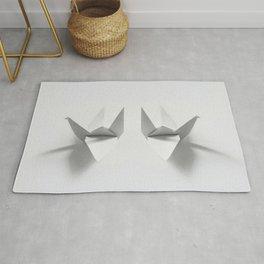 Paper origami crane Rug