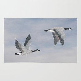 Canada geese and blue sky Rug
