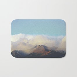 Sun kissed summit in the clouds Bath Mat