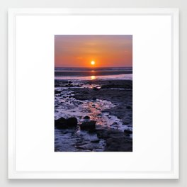 sunset over sand Framed Art Print
