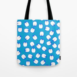 Penguins in the ocean Tote Bag