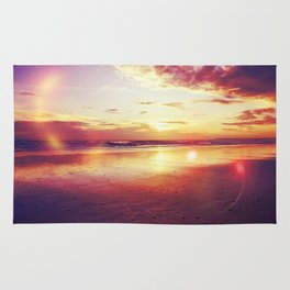Tropical sunset on a calm beach Rug