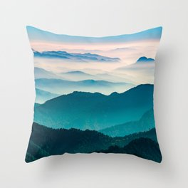 The Himalayan mountain range with visible silhouettes through the colorful fog from the Khalia top trek trail Throw Pillow