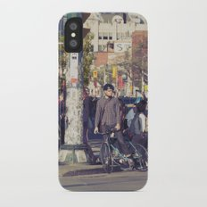 man in helmet stares wistfully across a busy intersection... iPhone X Slim Case