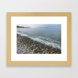 Tide going out on Pebble beach. Framed Art Print