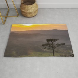 A lonely pine tree in the mountain Rug