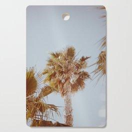 a palm tree xi Cutting Board