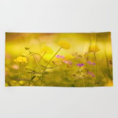 Wild flowers in the golden sunset shades Beach Towel