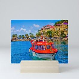 Orange Lifeboat Across Colorful Bay Mini Art Print