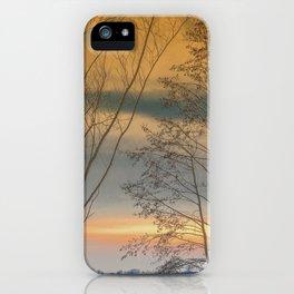 Evening sun over a lake iPhone Case