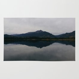 rocky mountain reflection Rug