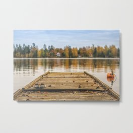 Pictuer of old slippers on the wooden pier with beautiful autumn background. Metal Print