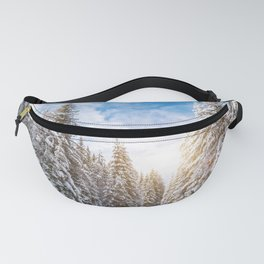 Winter pine forest in sunny day Fanny Pack