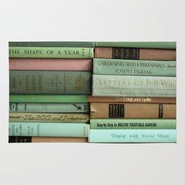 pastel book stacks Rug