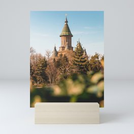 Church above the trees Mini Art Print
