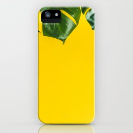 Tropical leaves on yellow background, space for text iPhone Case