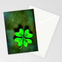 Four Leaf Clover on Green Textured Background Stationery Cards