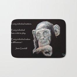 a Jane Goodall quote - black Bath Mat