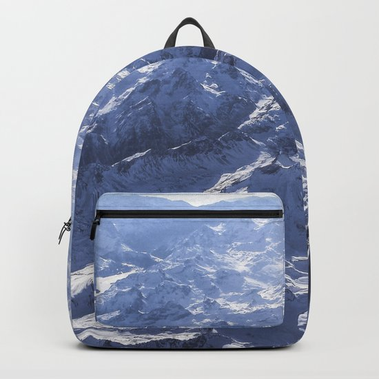 White mountains with snow winter nature Backpack
