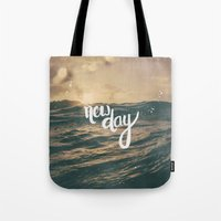 pocketfuel Tote Bags featuring NEW DAY by Pocket Fuel