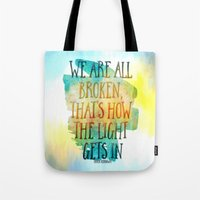 hemingway Tote Bags featuring We are All Broken Ernest Hemingway Quote by Ginkelmier