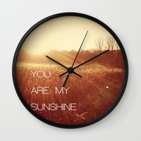 you are my sunshine Wall Clocks featuring You Are my Sunshine by Olivia Joy StClaire