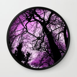 Purple evening moon through the trees Wall Clock