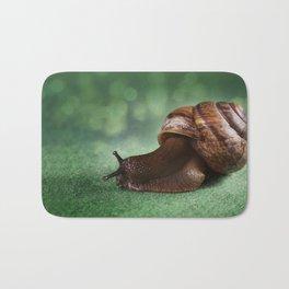 Garden snail on a green leaf Bath Mat