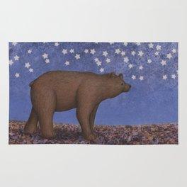 brown bear on a starlit stroll Rug