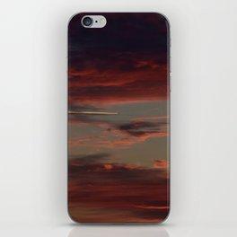 Airplane Soaring Through Sunset-Lit Clouds iPhone Skin