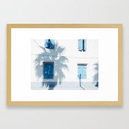 Blue windows and a palm Framed Art Print
