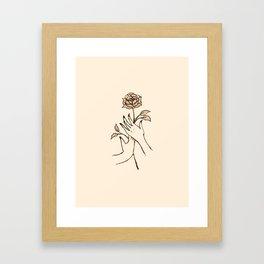 hold a flower. Framed Art Print